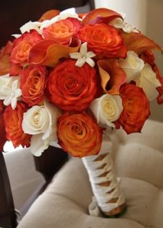 Orange calla lilies and roses with white accent flowers..... nix the white add some purple and who knows