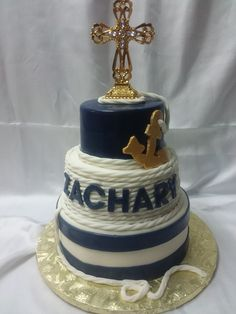Nautical baptism cake I made.  Top and bottom levels are blue velvet cake with a vanilla buttercream frosting.  Middle is coconut with coconut buttercream frosting.
