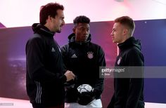 David Alaba (C) of Bayern Muenchen jokes with team mate Mats Hummels and Joshua Kimmich at the players' tunnel ahead of the UEFA Campions League match between FC Bayern Muenchen and Club Atletico de Madrid at Allianz Arena on December 6, 2016 in Munich, Bavaria, Germany.