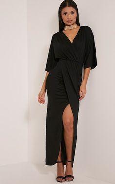 Black Cape Maxi DressFeaturing elegant maxi length and a contemporary wrap design, this sleek dre...
