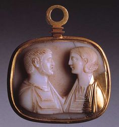 Medallion with cameo: facinf male and female busts    Jewel, gem, seal    3rd century AD (cameo) Roman    Gold and sardonica