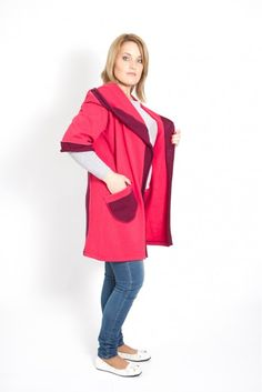 "Straight, hooded, woollen coat in contrasting pink and cherry colors featuring a wide hood which switches to a ""scarfy"" collar, an open front or may be belted waist, 3/4 sleeves, one patch pocket and a mid-length."