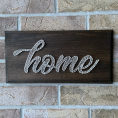"""Here's my latest piece, a simple """"home"""" sign with a beautiful dark walnut stain and routered edges. Cream thread makes this piece versatile to fit any decor. Dark Walnut Stain, Home Signs, Handmade Home Decor, Simple House, String Art, Nursery Art, Wall Collage, Wood Art, Rustic Decor"""