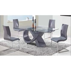The Pablo Dining Table Has A Tempered Clear Gl Top And Mdf Base Covered In