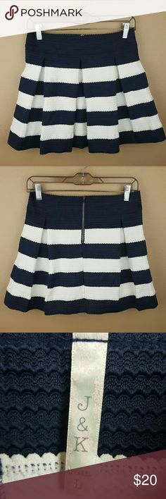 Navy Blue & White Striped Skirt A pretty and girly navy blue & white striped skirt by J & K.  • Fabric is thick, heavy, and stretchy. • 100% Polyester.  • Machine washable. • Size Large. • Laying flat: Waist 14.5 inches but very stretchy so it can stretch more! Length 16 inches.   Looks super cute with tights and booties! J & K Skirts Mini