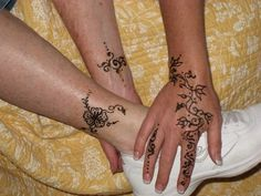 Henna Tattoos On Hand And Leg