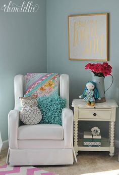 Using a variety of colors and mixing lots of patterns helps make for a fun nursery or little girls' room. We love adding in fun accents pillows like this gold owl and fluffy teal one both from @homegoods. (sponsored pin)