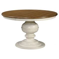 """Gather friends and family for Sunday brunch or a celebratory meal around this charming dining table, showcasing 1 leaf and a turned pedestal base.           Product: Dining tableConstruction Material: Maple wood veneers and select hardwood solidsColor: Cotton and mapleFeatures: One 20"""" removable leaf includedTurned pedestal base Dimensions: Without Leaf: 30"""" H x 50"""" Diameter With Leaf: 30"""" H x 70"""" W x 50"""" D"""