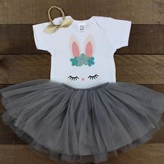 This adorable Easter Bunny shirt is made with a sweet Bunny Face, perfect for your little one, this Easter! The Vinyl is professionally cut and heat pressed and the glitter flakes do not shed. You also have the option to add an adorable gray tutu skirt that is super soft and high