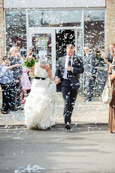 Confetti exit | Chicago Wedding at Loft on Lake from Gina Cristine Read more - http://www.stylemepretty.com/illinois-weddings/2013/10/03/chicago-wedding-at-loft-on-lake-from-gina-cristine/