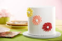 In The Wilton Method™ Course 1 you'll learn how easy it is to pipe lines and make simple borders, letters and shapes on your cakes. Sign up at @michaelsstores.