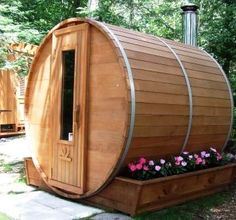 Round Cedar Sauna to match the hot tub...