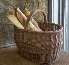 Willow Harvest Basket - This basket is a farmhouse natural and a foundational style piece with endless uses!Approximately Willow Basket Antique Farmhouse, Farmhouse Decor, Farmhouse Design, Park Hill Collection, Barn Door Console, Wicker Baskets With Handles, Harvest Basket, Bakery Kitchen, Berry Baskets