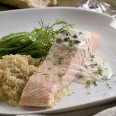 Poached Salmon with Creamy Piccata Sauce. Easy poached salmon is sophisticated with a creamy caper-and-lemon sauce. Make it a meal: Serve with snow peas or roasted asparagus and a whole grain like quinoa or brown rice. Sauce Recipes, Fish Recipes, Seafood Recipes, Cheap Recipes, Poached Salmon Fillet, Vegetable Couscous, Dinner Party Recipes, Heart Healthy Recipes, Food Dinners