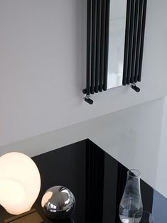 The mirror positioned in the mid section of the Reflex radiator enhances the minimalist design in terms of style and function.  #Reflex #Tubesradiatori #Radiator #Interiordesign
