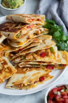 Loaded Chicken Quesadillas - The ultimate Quesadillas recipe! These are brimming with two kinds of gooey melted cheese and a flavorful, fajita style chicken and sautéed pepper filling. Talk about delicious Mexican comfort food everyone will go crazy for! Mexican Dishes, Mexican Food Recipes, Ethnic Recipes, Spareribs, Chicken Quesadillas, Chicken Taquitos, Fajita Recipe, Quesadilla Recipes, French Dip