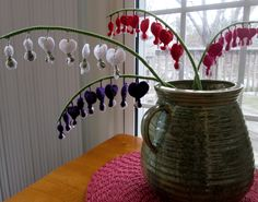 Crochet Bleeding Hearts pattern http://lynscrafts.com/yarnstore/patterns-for-sale/447-bleeding-heart-crochet-pattern.html