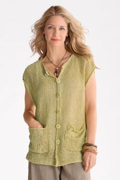 Time Travel Vest by Amy Brill Sweaters. This lovely, airy vest is perfect layered over a tank or cami in summer or over long-sleeve shirts in cooler weather. Its deep armholes allow for a great fit over your favorite big shirt, and its sideways-knit construction creates a fluid drape. Overview: Sleeveless Below hip length Two front pockets Button-front closure Artist-made in the U.S.A. Fabric 18) Garment measurements: Garment length (measurement taken from highest point on shoulder to the…