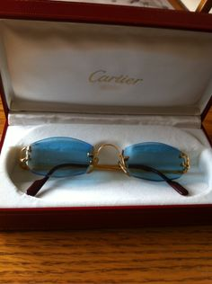 faccc9688b6a5 Authentic Cartier sunglasses Certificate of Appraisal with them. Blue rimless  lens with gold plated.  850