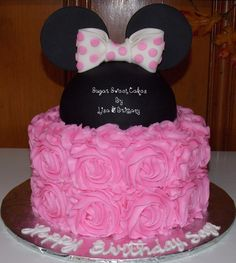 "Roses & Minnie Mouse - 3 layer, 8"" with a hat cake on top. Buttercream roses, fondant ""hat"", ears, & bow. TFL!"