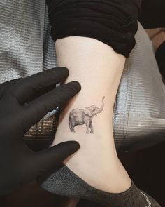 Little realistic elephant tattoo made on the ankle