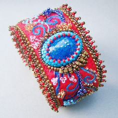 Hey, I found this really awesome Etsy listing at https://www.etsy.com/listing/53001213/fiery-red-bead-embroidered-fiesta-cuff