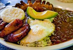 Bandeja Paisa  The ice on the streets is melting (yes! Latin American Food, Latin Food, Colombian Cuisine, Colombian Recipes, I Love Food, Good Food, Food Facts, Spanish Food, Main Meals
