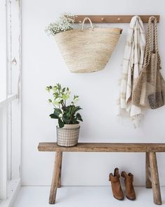 wooden bench with hooks in entry