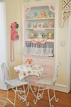Love this! So pretty & look at that vintage phone!  Creating Innovation Kitchen More Special with Furniture, Gadhet, Wallpaper, Decorated with Pink and White Color Style (18)
