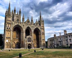 Peterborough Cathedral, England - begun by Abbot John de Sais on 8 March 1118 - Norman/Romanesque style - (also proto-Gothic) - known for its imposing Early English Gothic West Front (façade) which, with its three enormous arches, is without architectural precedent and with no direct successor.