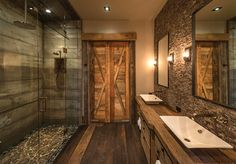 I am drooling over this bathroom. Reclaimed barn wood and river rock, so warm and rustic.