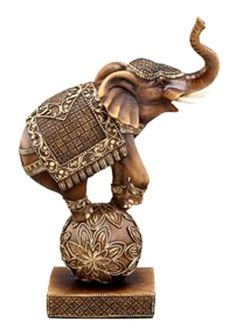 Preforming Circus Elephant Sculpture - Elephant standing on ball statue. So elephant is performing in a circus in this standing on a ball and dressed for the circus. A beautiful piece to display.