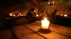 stock-footage-burning-candle-on-a-wooden-table-in-old-restaurant-of-tallinn-estonia.jpg