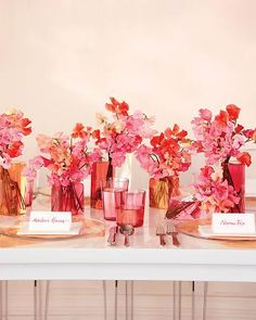 A Tinted Tablescape  See the world through rose-colored glasses. Here, sweet peas are arranged in simple glass containers and multifaceted vases filled with subtly dyed water (just add organic food coloring) to create a vivid centerpiece.