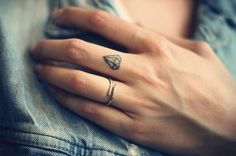 small diamond tattoo on finger