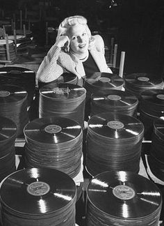 Peggy Lee posing w. a stack of her latest hit song Manana at Capitol Records, 1948. Photo by Allan Grant//Time Life Pictures/Getty Images. °
