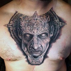 Aztec inspired tattoo on chest