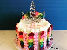 Create a magical rainbow cake with candy melts and buttercream. I also added a unicorn cake topper to make it even more fun