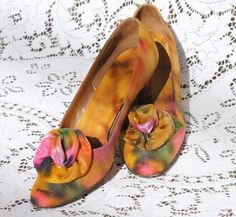 1950s shimmery pumps. Made for Best Apparel in Seattle, these little pumps are made of a bright satin fabric with a touch of gold shimmer. The
