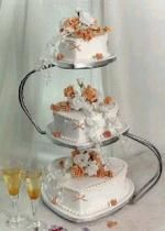 wedding cake royal iced with orange flowers and heart shape cake in three tier