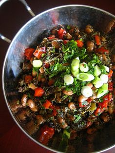 Have you ever had Thibkha? it's a flavorful, spicy North African dish with pinto beans and kale!