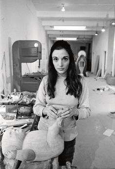 """Jack Mitchell, """"Portrait of Sculptor Marisol Escobar at Work on & 'The Family' Sculpture"""" (1969), photograph, Memphis Brooks Museum of Art, Memphis, TN; Museum purchase with funds provided by Marina Pacini and David McCarthy in honor of Mimi Trujillo Ruthizer (© Estate of the artist)"""