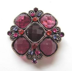 Red and Wine Very Unique and Collectable Brooch Pin - Missing Fastening Pin Gifts by Lulee/Brooch. $9.99. Exquisitely detailed designer style. Missing the back pin - Great to use in a Gourd or hat. Definately an eye catcher. Good quality and workmanship.. about 2 inches x 2 inch