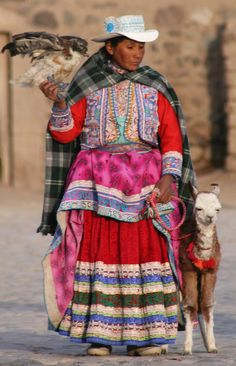 A woman with her llama and her hawk, Cailloma, Peru