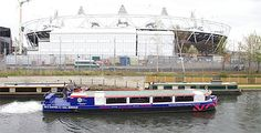 Water Chariots has been granted the exclusive licence to provide a canal boat service along the River Lea, to the Olympic Park, docking just 70 meters from our own exclsuive fast-track entrance into the Stadium.  The only way you can get closer is if you're a competing athlete.