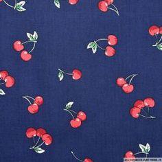 Coton imprimé petites cerises sur fond bleu