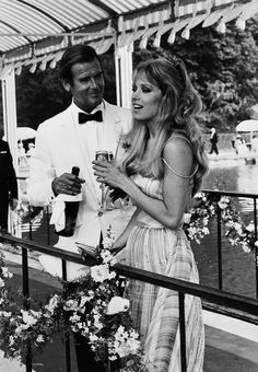 """If it's you were expecting me"""", James Bond (Roger Moore) says to CIA agent Holly Goodhead on spotting a bottle of Bollinger R. in her bedroom: this scene soon became one of the signature lines from Moonraker Bollinger Champagne, James Bond Actors, Bond Issue, James Bond Style, Roger Moore, Sean Connery, Mans World, Black And White Pictures, Writers"""