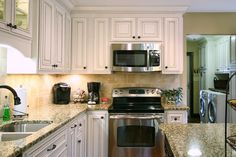 Let us build your dream kitchen! Give us a call at 704-434-0823 or visit our website http://walkerwoodworking.com/#WalkerWoodworking #Custom #CustomCabinets #Kitchen #KitchenDesign #GlassDoors #PaintedCabinets #Island #KitchenLighting