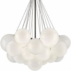 Get a fresh new look with the Nuage Chandelier in one of 3 different sizes.  This piece is comprised of hand crafted iron in a vintage bronze finish, and contrasted by clear glass globes with frosted interiors.  This stunning fixture has a lovely bubble like appearance that seems to float above the room.  Nuage is a stunning and contemporary fixture that will bring a beautiful unique look to your space.  Available in three sizes  Material: Clear Glass/Iron Finish: Frosted Inside/Vintage…