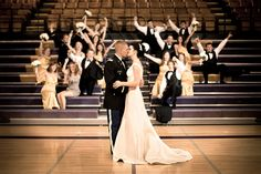 This bride and groom share a kiss in the gym at the school they were high school sweethearts in. Swoon.  #brideside #realwedding #wedding #highschool #sweethearts #kiss #love #photography #moments  High sweethearts have a hometown wedding with pops yellow. | Brideside